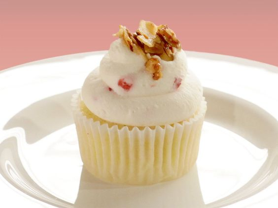 """Cupcakes With Pineapple Filling and Strawberry and Goat Cheese Whipped Cream : Judge Bellanger compliments baker Marilyn Norris on her elegant cupcake, which is topped with a strawberry-studded goat cheese frosting. """"This is what I'm talking about. I really can taste the white wine ... and the goat cheese is a nice touch,"""" he says."""