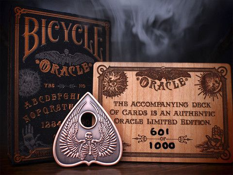 Oracle Bicycle Limited Edition package   Dead On Paper.   Only 1000 of these fantastic decks was produced!     A black velveteen bag containing the Bicycle ORACLE deck, a numbered wooden spirit board and a miniature bronze planchette.  Truly a collector's item worthy of your collection!