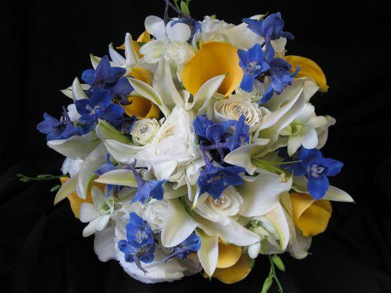 Blue delphinium, White ranunculus and Dendrobium orchids ...