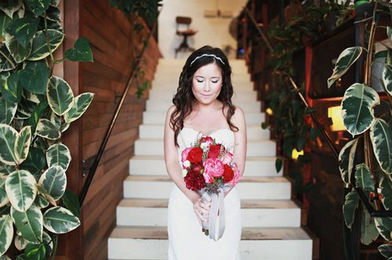 Beautiful bride with red and pink bouquet, love the heart details of this wedding - greenweddingshoes.com