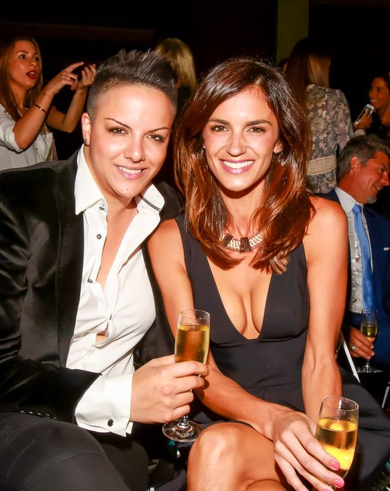 Shadi Kazeme and Chelsea Butler enjoyg a glass of Laurent-Perrier Champagne front row before the show begins! X