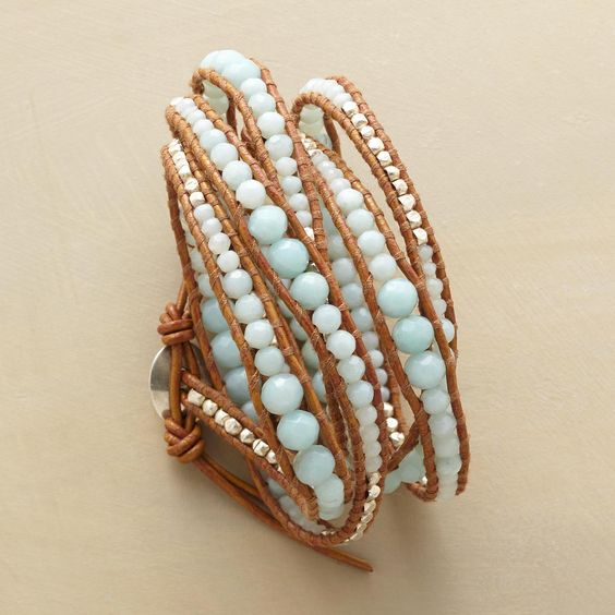 "WAVY 5 WRAP BRACELET -- A light blue Chan Luu bracelet that features alternating graduated amazonite beads and sterling silver nuggets in a 5-wrap ebb and flow. Handcrafted. Sterling silver button closure. Leather. 32"" to 34""L."