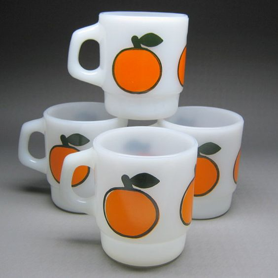 Fire King milk glass mugs with a bold orange fruit graphic.  I don't need any more mugs (says my husband).  Go get this from Etsy.