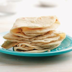 Homemade Tortillas Recipe  •2 cups all-purpose flour  •1/2 tsp salt  •3/4 cup water  •3 tbs olive oil  Directions  •combine flour  Stir in water & oil. Turn onto a floured surface; knead 10-12 times,  Let rest for 10 min.  •Divide into 8 portions. On a floured surface, roll each portion flat.   •In a large nonstick skillet w/cooking spray, cook on medium heat 1 minute each side or until lightly browned