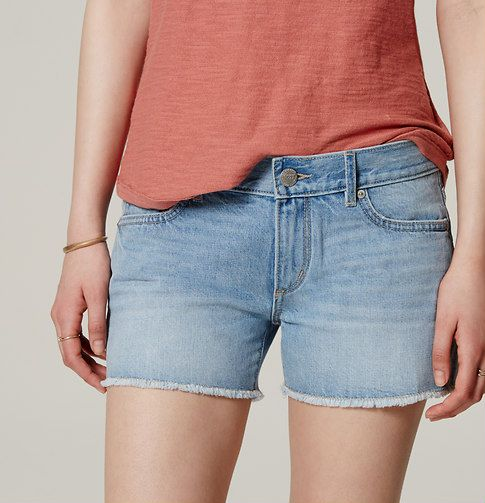 """In an original light indigo wash, our cut-off denim shorts exude free-spirited cool in a flattering and comfortable way. Zip fly with button closure. Belt loops. Five-pocket styling. Tonal topstitching. Distressed detail. Frayed hems. 3"""" inseam."""