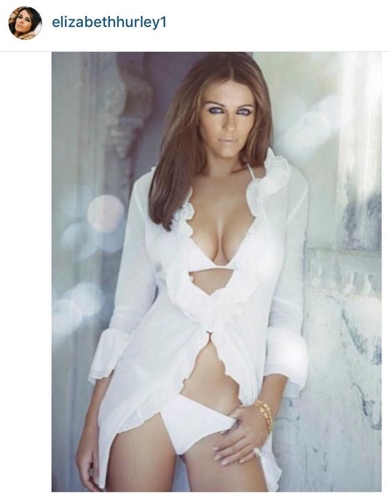 Elizabeth Hurley stunning in a white cleavage baring bikini