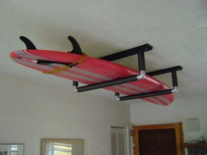 Paddle board storage like this but our ceilings are so high. Wonder if would work on wall