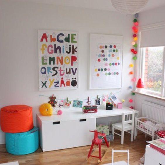 "Colour on white.  Stuva ikea furniture. Lovethe alphabet poster and the Damien Hurt""esque"" print beside it"