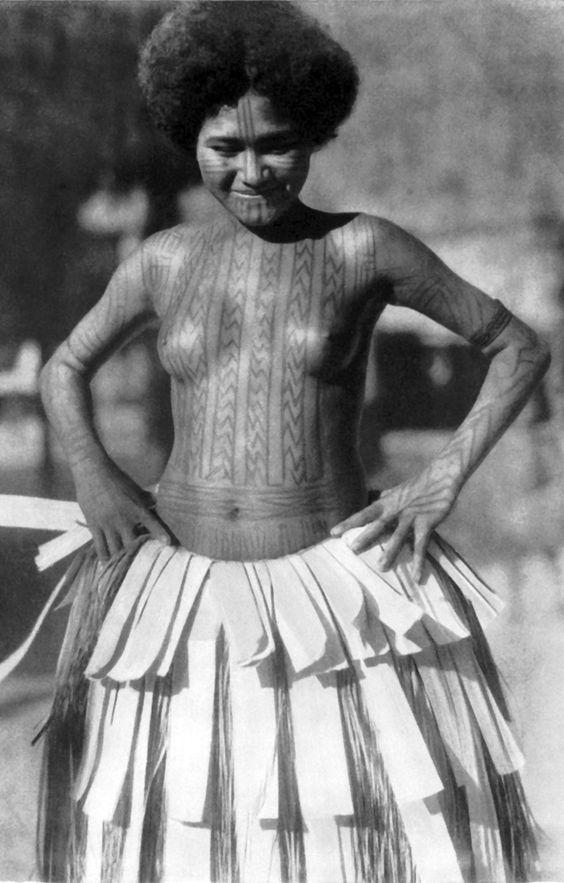 South Seas ~ Mailu Island | A young girl proudly shows off her tattoos. ca. 1937 | Photo Hugo Bernatzik | Source; http://www.ebay.co.uk/itm/1934-BALI-SOUTH-SEAS-OWARIKI-SOLOMON-ISLANDS-NEW-GUINEA-Hugo-Bernatzik-Fab-Fotos-/171169010238