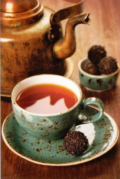 Tea and chocolate truffles. Just need some flurries, a chill in the air, a big sweater, and a good book.: