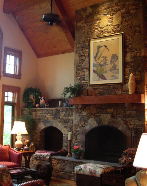 Natural stone wood burning fireplace with arch opening and for New construction wood burning fireplace