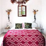 love the addition of the pink/red bedspread. an easy way to incorporate color into my room?