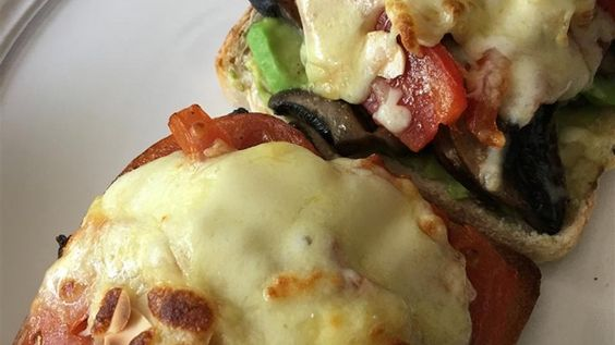 This fresh and easy open-face melt is made with avocado, mushrooms, almonds, and tomato. Sub provolone, mozz or low fat white cheddar for Swiss