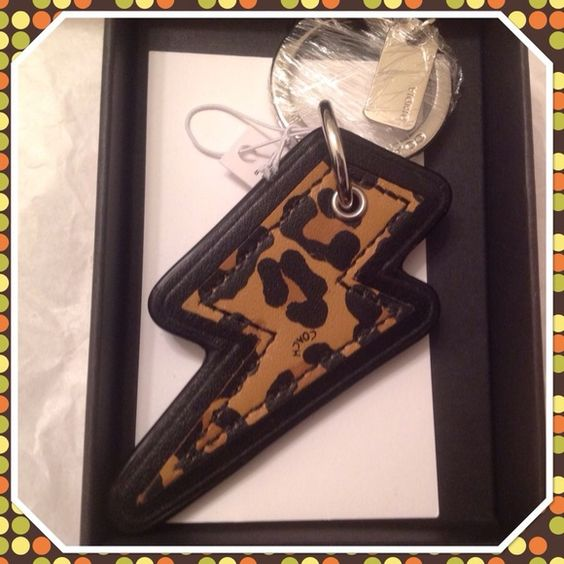 Coach Ocelot Thunderbolt Keyfob Keychain NWT This is a brand new in box Coach Ocelot Thunderbolt Keyfob.  Leather with silver hardware.  Comes in a Coach gift box.  Style F64579. Coach Accessories Key & Card Holders
