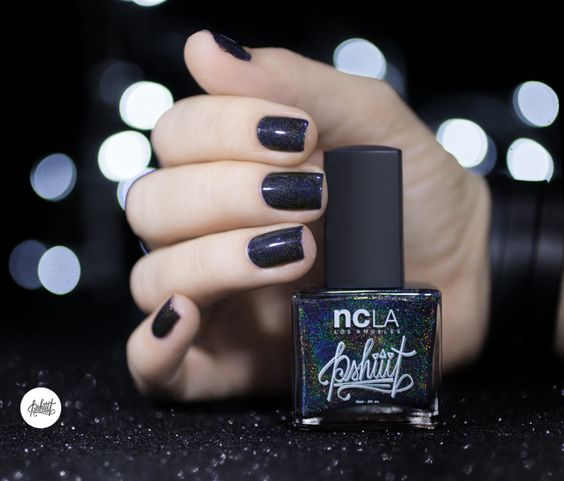 WANDERING STARS NCLA black holo nailpolish. Still a great way to get festive even with an edge! Shop NCLA on www.frendsbeauty.com