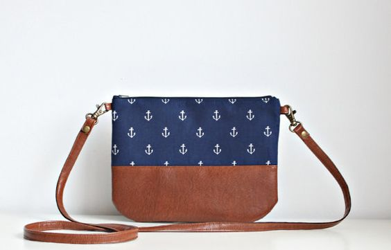 Navy bluie crossbody vegan leather and cotton small bag great for every day use. It will fit your most essential things inside such as phone, keys,