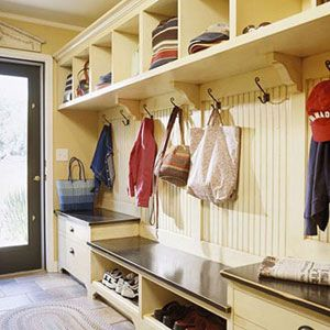 I'm thinking of this for our odd room.    Ideally, a well-designed mudroom should have open hook storage for hanging coats and bags, shelves or drawers for hats and gloves, space for dirty or wet shoes, and closed cabinets for additional items. Additionally, a built-in bench will make it even easier for someone to sit and take off their shoes