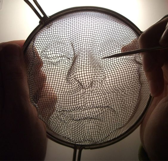Strainer Faces by Isaac Cordal
