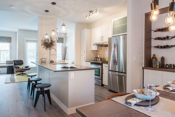 Reef Townhomes Kitchen, light fixtures, wall wine rack, kitchen island, stools
