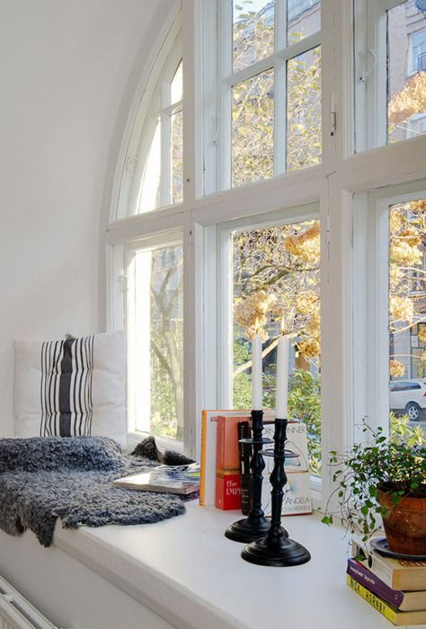 window envy (via Color, Simplicity and Function in a Small Scandinavian Crib   Freshome)