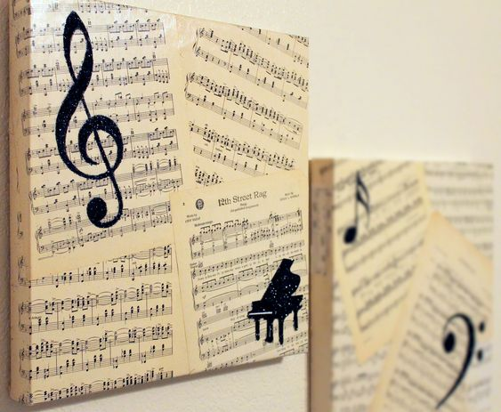 Canvas covered with decades old sheet music, overlaid with musical symbols in black glitter. <3 this!