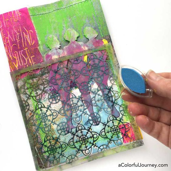 Stenciling the cover of an art journal with silhouettes by Carolyn Dube