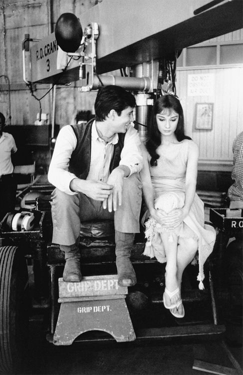 """Anthony Perkins and Audrey Hepburn on the set of """"Green Mansions""""."""