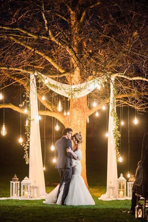 lit tree as wedding ceremony backdrop#weddings #weddingideas #weddingarces #weddingdecor