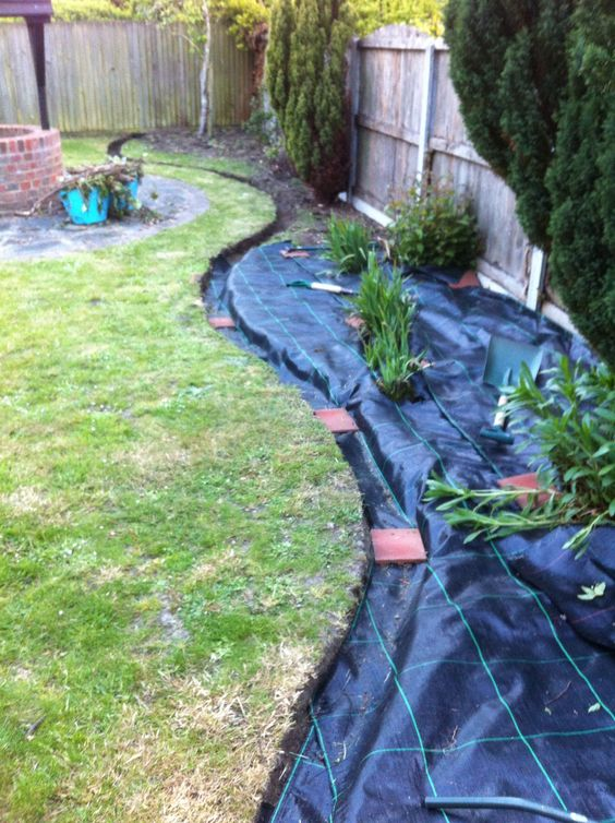 Perpetration for the boarder dig a shallow trench for the stone and also to hide the covering