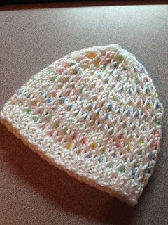 A new pattern for a baby hat. I saw this stitch on a baby cardigan pattern and thought it would make a cute hat. It does! The pattern is written for a newborn, but increasing the cast on in increments of 12 will work to make larger sizes.