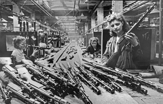 Women work on the assembly line at a submachine gun factory in Moscow, 1943.