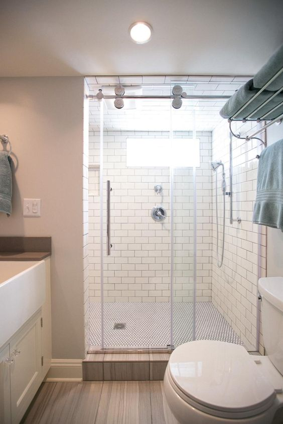 SHOWER DOOR... White subway tile with dark grout creates a pleasing contrast in the walk-in glass shower.