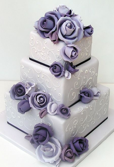 3 tier square wedding cake with lavender sugar roses