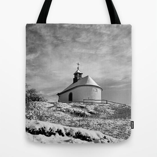Chapel in the snow Tote Bag Chapel in the snow Art Print A very little chapel on a hill on a winter morning. I turned the pic into b&w, it looks more elegant than the colorful original pic, I think.  nature, winter,snow,snow-covered,chapel,religious building,trees,black and white,b&w, landscape