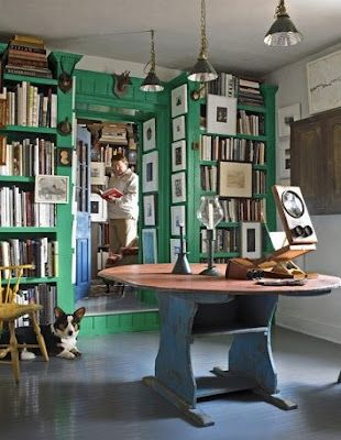 the library of Anne Gridley and Gary Graves, which has been painted in Benjamin Moore's Prairie Green.