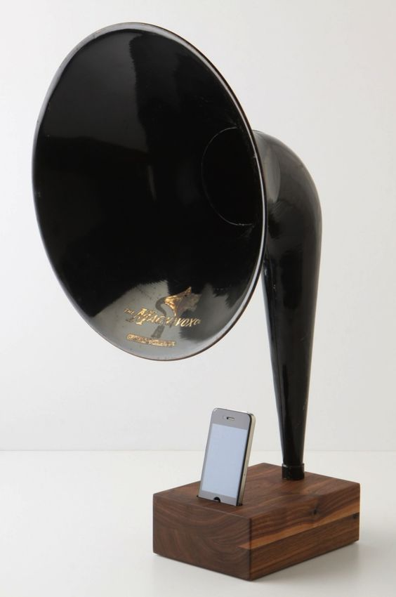 iVictrola iPod Dock. Grammophone style for modern folk! This is apparently a real product, sold in the UK under the Anthropologie umbrella, but it's so ridiculously expensive that, alas, it is but an admiring lookie-loo in Christatown. :)