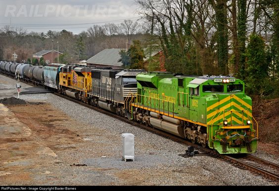 NS 1072 leads a loaded ethanol train southbound through Rome, GA, past the site of the former train station on a dreary afternoon. At least the 1072 provided some color to an otherwise grey day!