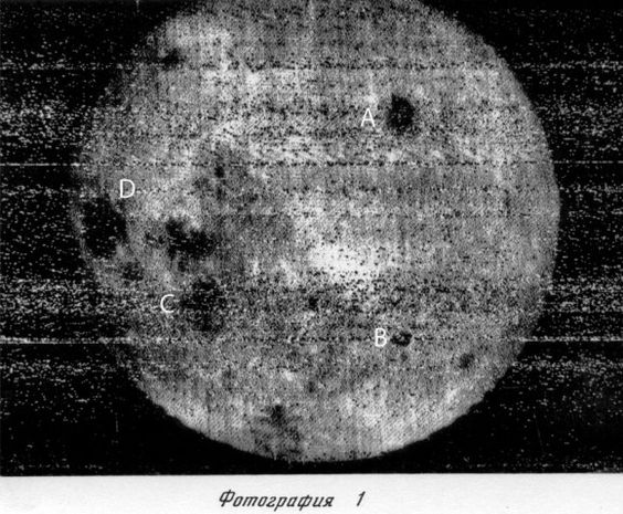 """First ever look at the far side of the Moon. The photo was taken by the Soviet spacecraft Luna 3 on Oct. 7, 1959. The right three-quarters of the disk is the far side. A = Mare Moscoviense, B = Tsiolkovsky Crater with central peak, C = Mare Smythii (on the near side-far side border) and D = Mare Crisium (near side). (Credit: Roscosmos) Mona Evans, """"The Moon - Earth's Daughter"""" http://www.bellaonline.com/articles/art32833.asp"""