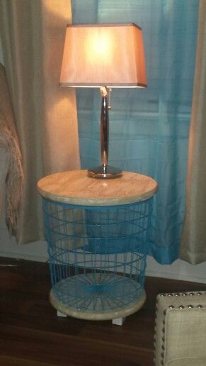 My diy accent table wire laundry basket and cut circle top and bottom