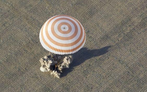Soyuz capsule lands in Kazakhstan, brings American, two Russians back to Earth