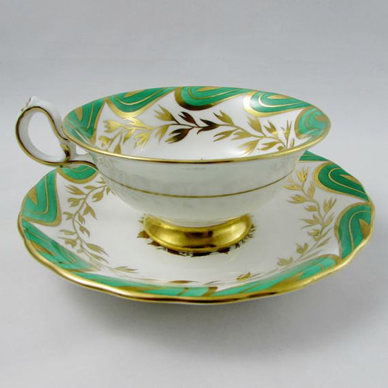 Royal Chelsea tea cup and saucer, green with gold leaves and flowers in the center. Gold trimming on the cup and saucer edges. Excellent condition (see photos). Markings read: Royal Chelsea English Bone China Made in England Please bear in mind that these are vintage items and there