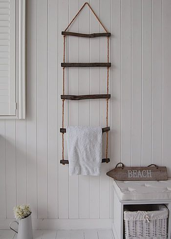 Decorative rope ladder for towel storage adds to the bathroom decor. Great for small spaces and storage limitations
