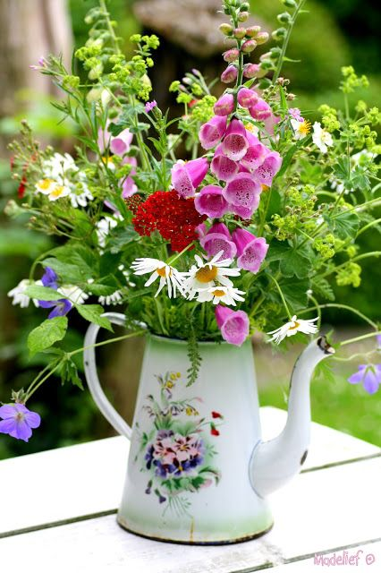 Jug of wild flowers... nice tin teapot, good as a centrepiece for the outside table and chairs.: