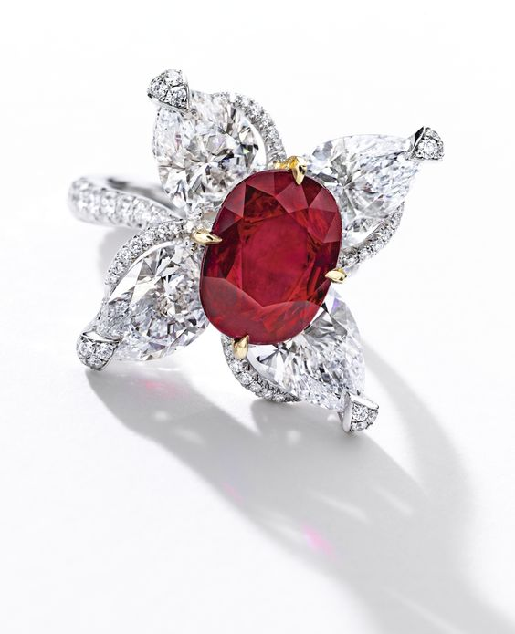 Important Ruby and Diamond Ring Set with an oval ruby weighing 5.07 carats, surrounded by four pear-shaped diamonds weighing 7.56 carats in total, accented with circular-cut diamonds, mounted in platinum and 18 karat yellow gold. Ring size: 5½