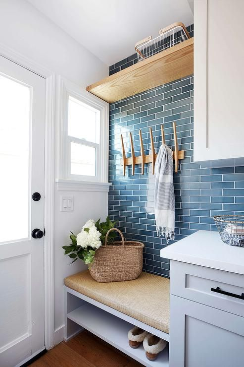A Light Gray Built In Bench Boasting A Shoe Shelf Is Topped With A Tan Seat Cushion And Mounted Against Blue Sub Home Blue Subway Tile Laundry Room Inspiration