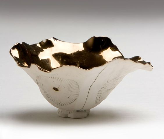 IMISO Ceramics. I love the peaceful white against the shocking metallic gold. Shape = lovely and interesting, lively.: