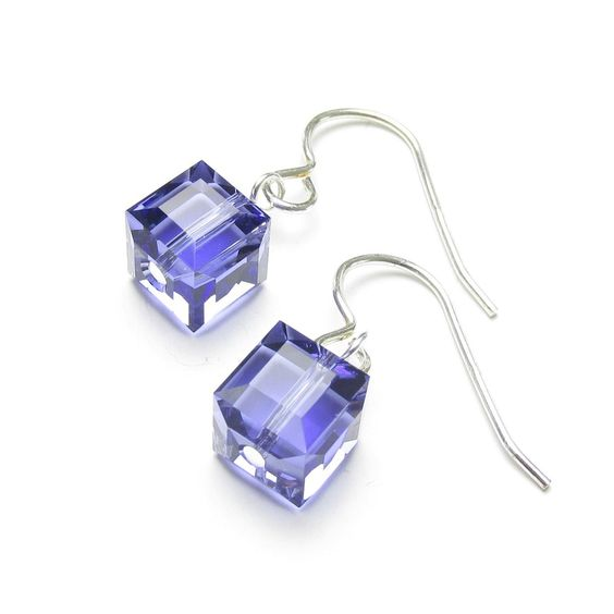 £15 These Zahira crystal cube earrings are perfect for the House of Colour winter palette, with sparkling tanzanite purple cubic swarovski crystals  hung from sterling silver ear hooks.  'Zahira' means 'Brilliant, shining'; which these stunning earrings really  do as they catch the light.  Other colours from the winter Swarovski crystal palette may be available  for these earrings, please email us to see if the colour that you would  like is available.