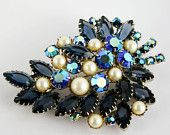 O is for Ocean: An EcoChic Team Treasury by PinkChampagneFashion that features our DeLizza and Elster Style brooch. Double click thru to see some more great vintage ocean inspired items!