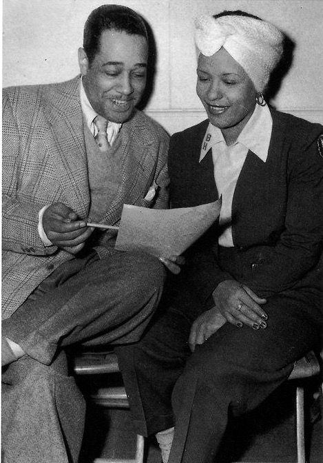 Billie Holiday smiles at Duke Ellington's musical suggestion.