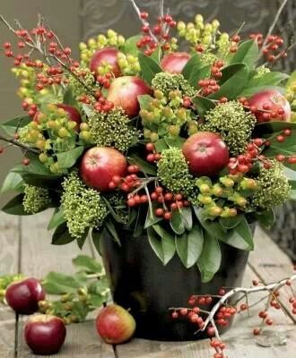 Fall/Winter Flower Arrangement - Fruit has become very popular to place inside of flower arrangements, so the apples allow for a modern take to a holiday arrangement.: